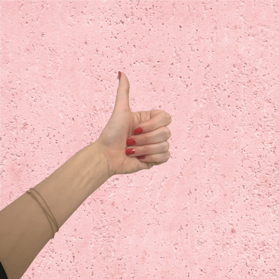 thumbs up on pink background