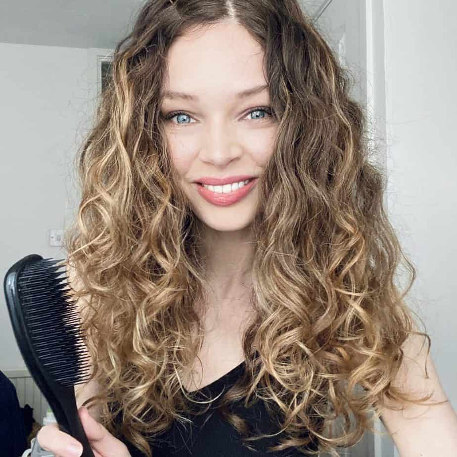 my favourite curly hair tool is a detangling brush